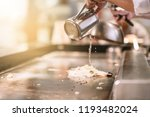 hand of man take cooking of... | Shutterstock . vector #1193482024