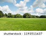 large trimmed green grass... | Shutterstock . vector #1193511637