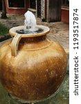 fountain in the garden with... | Shutterstock . vector #1193517874