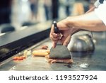 hand of man take cooking of... | Shutterstock . vector #1193527924