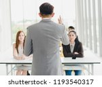 asian male speaker is speaking... | Shutterstock . vector #1193540317