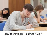 boy looking up from class and... | Shutterstock . vector #119354257