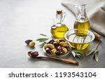 bottle of extra virgin healthy... | Shutterstock . vector #1193543104
