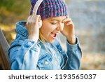 girl listens to music in... | Shutterstock . vector #1193565037