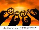 gears in the hands of people... | Shutterstock . vector #1193578987