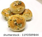 garlic knots with parsley on a... | Shutterstock . vector #1193589844