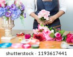 female florist at work using... | Shutterstock . vector #1193617441