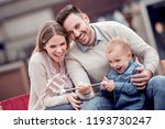 happy family taking selfie... | Shutterstock . vector #1193730247