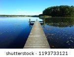 wooden bridge in lake with calm ... | Shutterstock . vector #1193733121