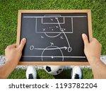 hand of a football coach... | Shutterstock . vector #1193782204