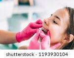 orthodontist fixing girl s...   Shutterstock . vector #1193930104