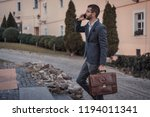 young handsome businessman... | Shutterstock . vector #1194011341
