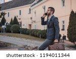 young handsome businessman... | Shutterstock . vector #1194011344