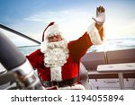 santa claus on boat and free... | Shutterstock . vector #1194055894