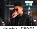 black african rapper performing ... | Shutterstock . vector #1194066637
