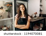 young beautiful florist in a... | Shutterstock . vector #1194070081
