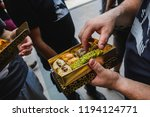 people enjoying a box of... | Shutterstock . vector #1194124771