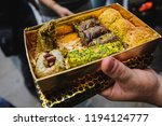 people enjoying a box of... | Shutterstock . vector #1194124777