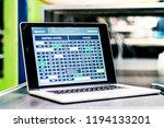 a laptop on a desk in a factory. | Shutterstock . vector #1194133201
