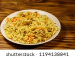 pilaf with meat  rice  carrot... | Shutterstock . vector #1194138841