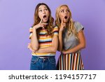 two pretty shocked young girls... | Shutterstock . vector #1194157717