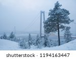 View at Hoga kusten bridge in winter in Sweden. Hoga kusten suspension bridge in Sweden. Cloudy winter weather
