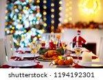 christmas dinner at fireplace...   Shutterstock . vector #1194192301