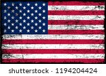 grunge american flag.old dirty... | Shutterstock .eps vector #1194204424