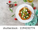 omelet with fresh tomatoes ... | Shutterstock . vector #1194232774