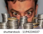 focus on coin. a rich greedy... | Shutterstock . vector #1194234037
