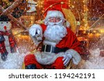 santa claus sitting on his... | Shutterstock . vector #1194242191