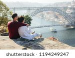 a gay couple traveling and... | Shutterstock . vector #1194249247