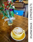 coffee latte on the wooden table | Shutterstock . vector #1194256171