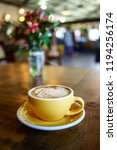 coffee latte on the wooden table | Shutterstock . vector #1194256174