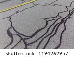 asphalt road with filled cracks.... | Shutterstock . vector #1194262957