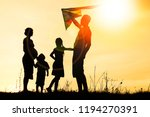 happy family playing on nature... | Shutterstock . vector #1194270391