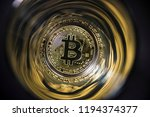 gold coin bitcoin on abstract... | Shutterstock . vector #1194374377
