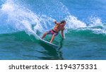 riding the waves. costa rica ... | Shutterstock . vector #1194375331