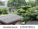 heavy rain and houses | Shutterstock . vector #1194378511