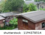 heavy rain and houses | Shutterstock . vector #1194378514