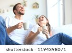 cheerful young couple in the... | Shutterstock . vector #1194398071