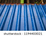 rain on the blue roof | Shutterstock . vector #1194403021