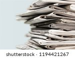 pile of newspapers on white... | Shutterstock . vector #1194421267