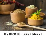 heaps of various ground spices... | Shutterstock . vector #1194422824