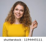 young woman in yellow listening ...   Shutterstock . vector #1194445111