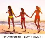 portrait of three young women... | Shutterstock . vector #1194445234