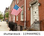 american flag on a building in... | Shutterstock . vector #1194449821