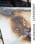 burned out car after a car... | Shutterstock . vector #1194452047