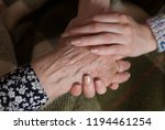 young woman hands are holding... | Shutterstock . vector #1194461254