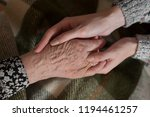 young woman hands are holding... | Shutterstock . vector #1194461257
